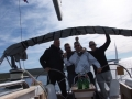 The winning crew on boat Bura with skipper Miro Volaric, a moment after passing the finish line