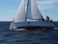 Boat Dori in Bura conditions in front of Stara Baska, island Krk